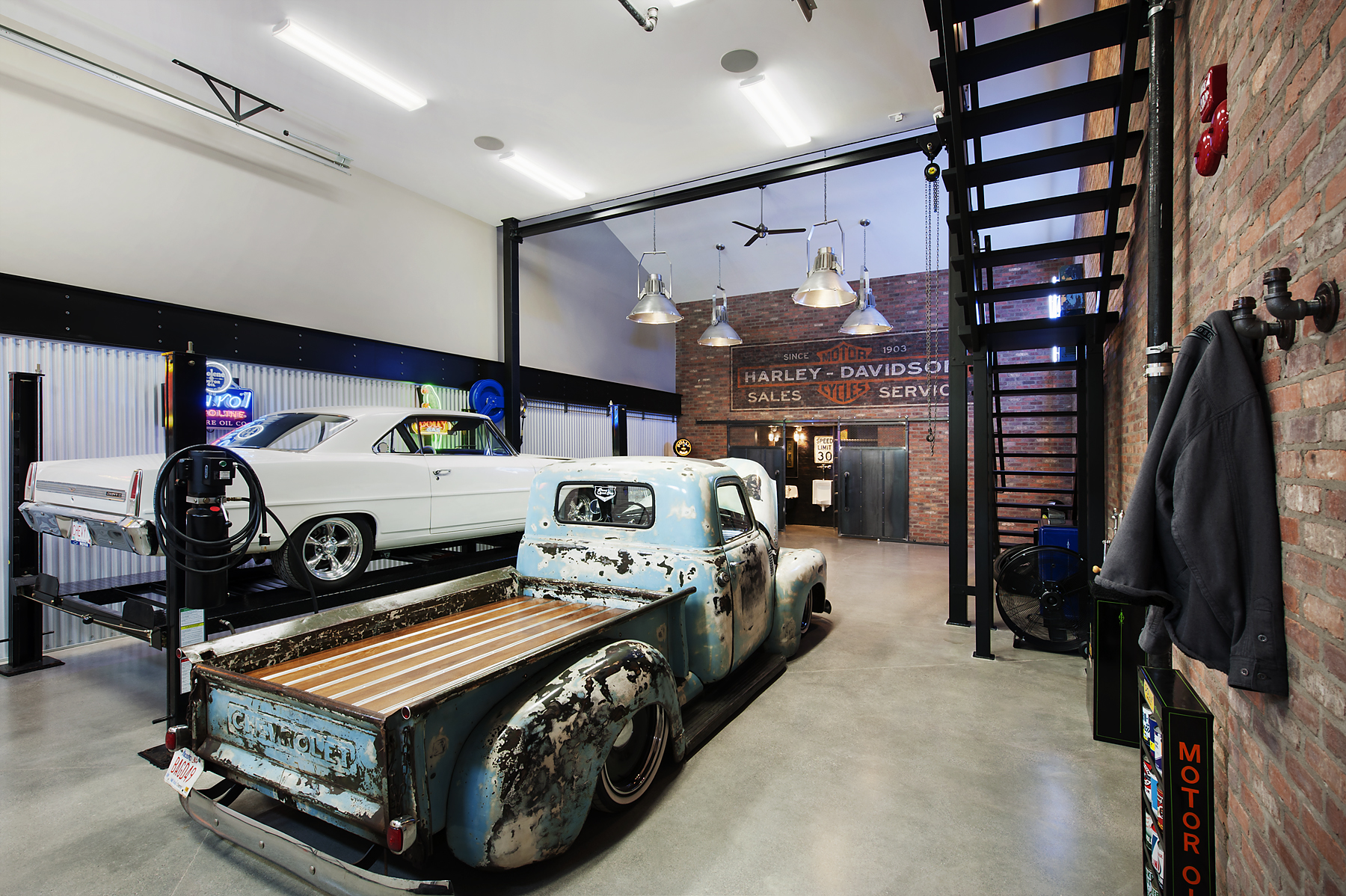 The Stash Luxury Garage by RockCreek Builders Inc.